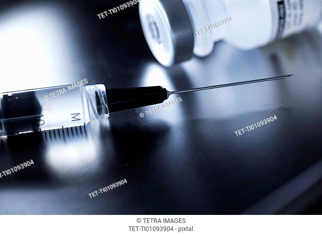 Studio shot of syringe and vial