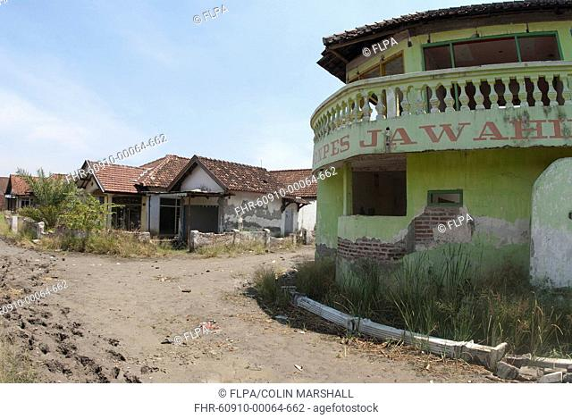 Abandoned village in dried mud following flooding by mud lake of mud volcano, environmental disaster which developed after drilling incident, Porong Sidoarjo