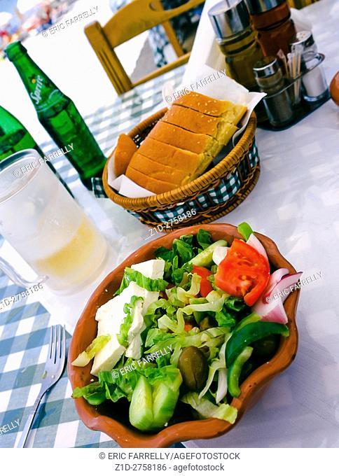 Greek salad on table. Beach side restaurant. Island of Rhodes Greece