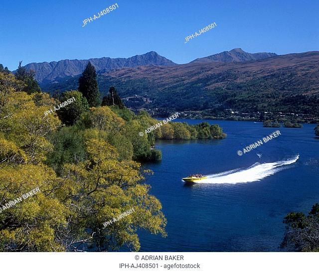 Tourist speed boat ride on Kawarau River which leads from Lake Wakatipu near Queenstown in the Otago Region of South Island