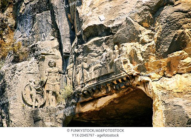 Pictures & images of the ancient Lycian rock cut tomb of a Gladiator whose rock relief sculpture can be seen with his family , Myra, Anatolia, Turkey