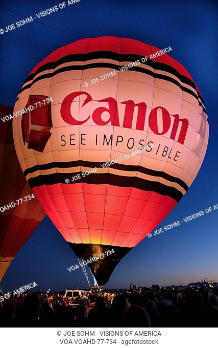 OCTOBER 7, 2017 - Albuquerque, New Mexico - Colorful Hot Air Balloons at Morning Glow Event at the Albuquerque Balloon Fiesta features Canon Cameras Balloon