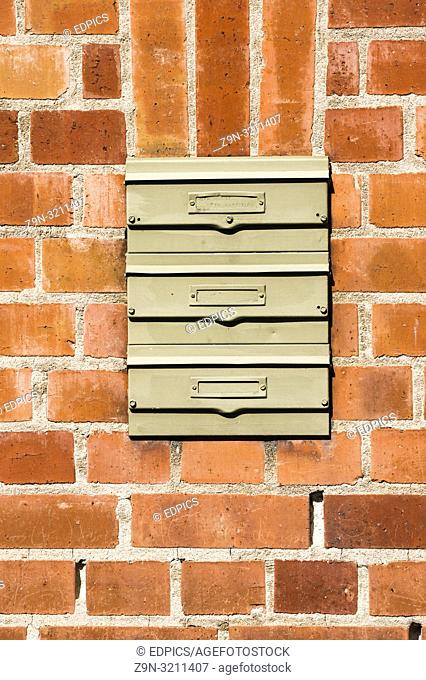 brick wall with three letterboxes without names, heilbronn, baden-wuerttemberg, germany