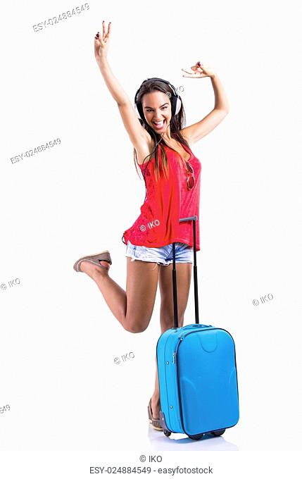 Happy and beautiful young woman going on vacation