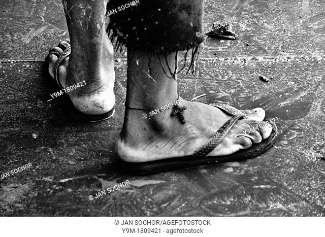 A Brazilian man wears the Christian cross symbol on his ankle as a protection against drowning in the river  Descendants of the Amazonian indigenous people are...
