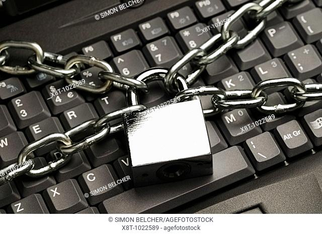 Padlock and Chain on Laptop Computer Keyboard