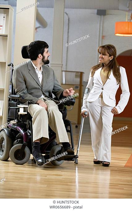 View of a handicapped man and woman conversing