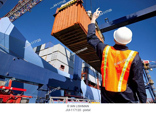 Worker Supervising Loading Of Containers At Port
