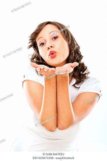 Young woman giving heart sign, isolated on white background