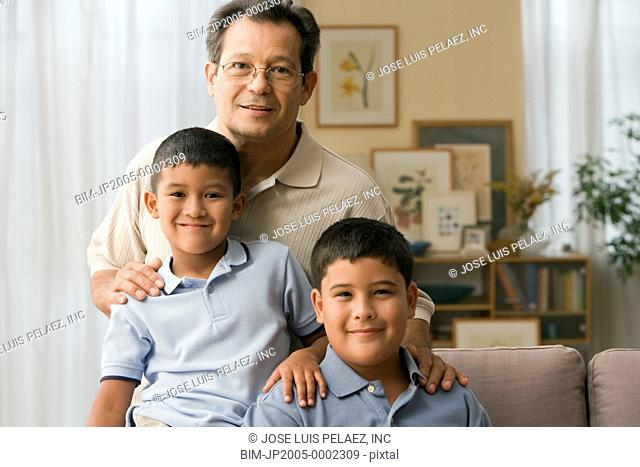 Father and sons smiling for the camera