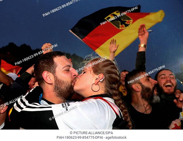 23 June 2018, Berlin, Germany : World Cup 2018, Football: Germany vs Sweden , Preliminary round, Group F, 2nd game day. Cheering fans kiss after the goal of the...