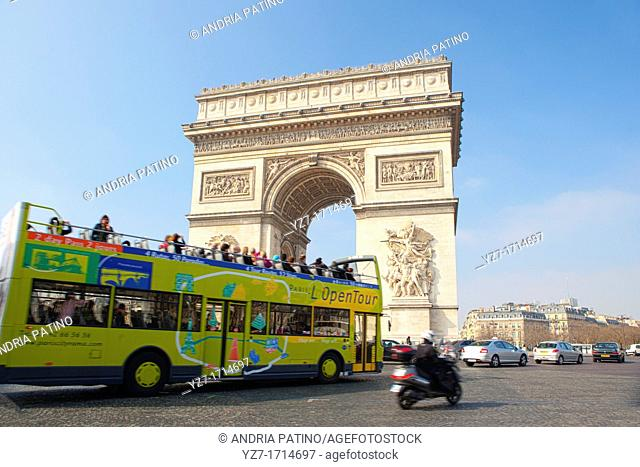 Tour bus entering traffic circle around the Arc de Triomphe
