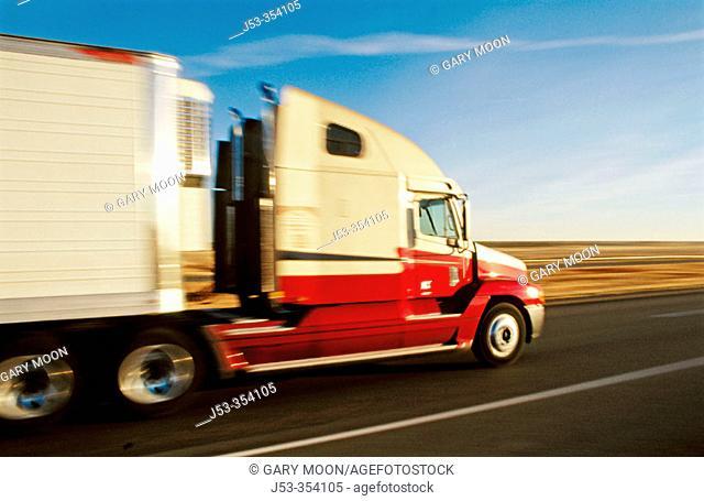 Big rig truck on interstate, blurred