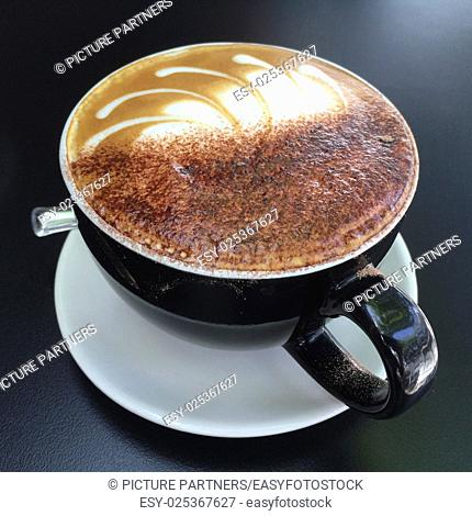 Cup of tasty cappuccino