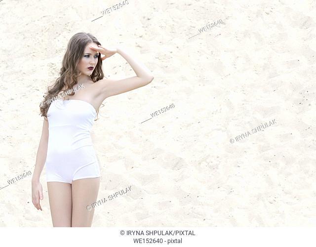 Young girl wearing white bodysuit