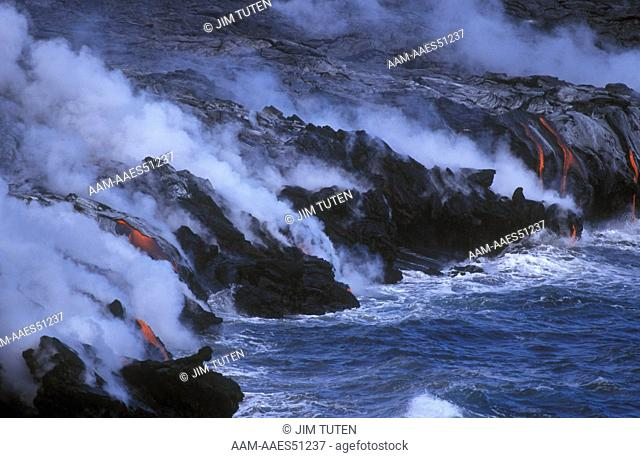 Glowing Lava from Kilauea Volcano pours into Ocean, E. Rift Zone, Big Island, Hawaii