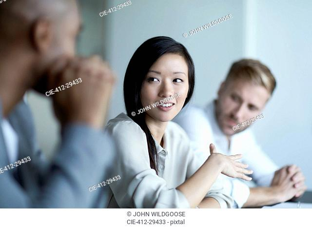 Businesswoman gesturing and talking in meeting