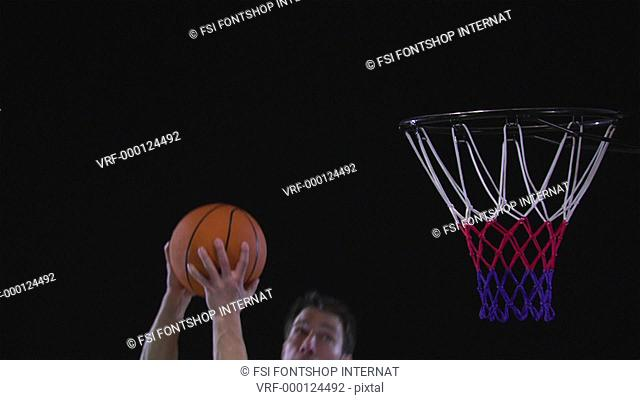 SLO MO, CU, Lockdown basketball player dunking a basketball into a basketball hoop