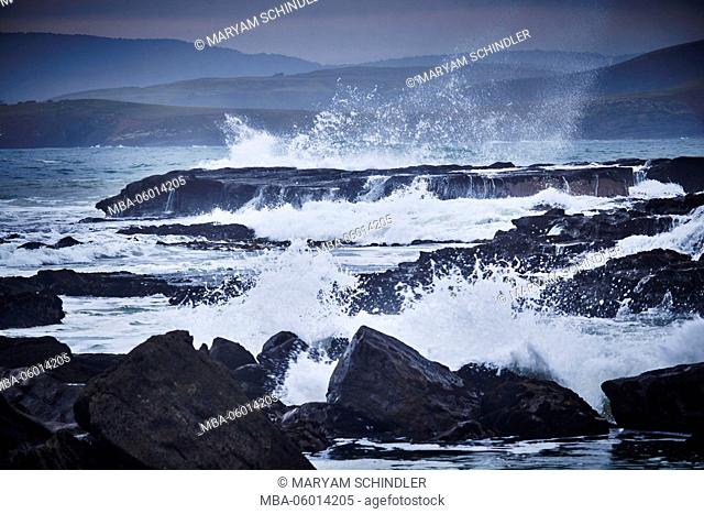 New Zealand, south island, southern scenic route, the catlins, jagged coast, waves whip against the rocks, gloomily