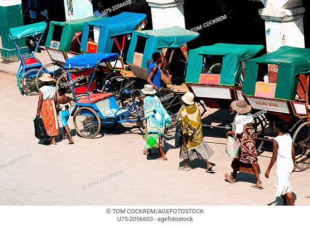 Street scene with pousse-pousse, Tulear, Madagascar