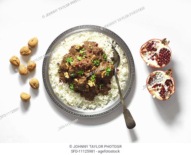 Persian chicken ragout with walnuts and pomegranate seeds