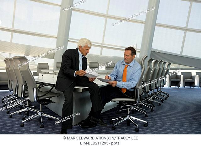 Caucasian businessmen talking in conference room