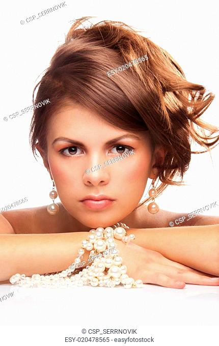 Woman with pearls necklace laying on her hands