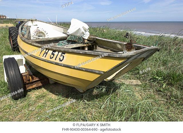 Redundant small fishing boat, decline of local fishing industry, North Norfolk, England