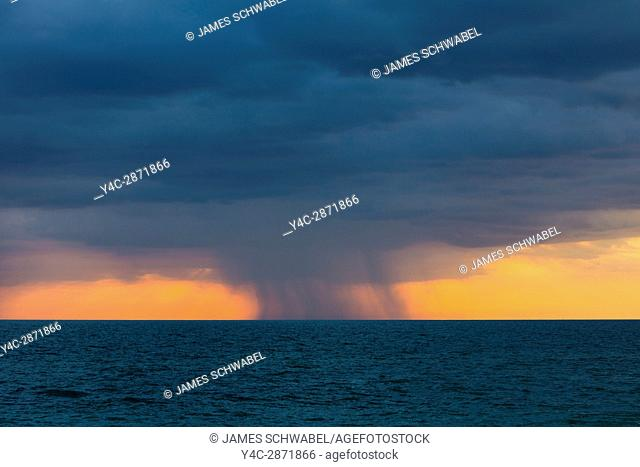 Rain storms over the Gulf of Mexico at sunset on the west coast of Florida