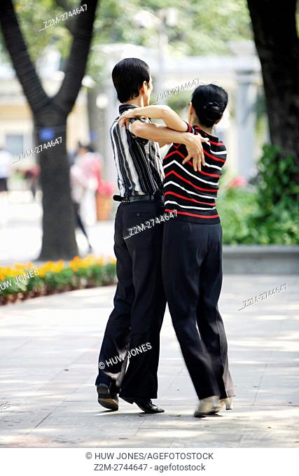 Couple during a public dance lesson on Shamian Dao Sand Surface Island, Guangzhou, China