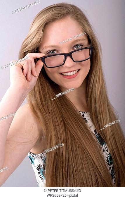 Attractive teenage girl wearing spectacles with a black frame