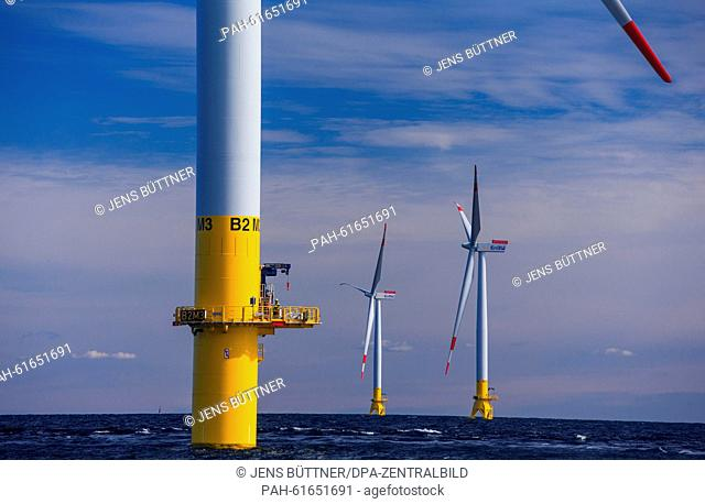 Technicians work on a platform at the offshore wind park 'Baltic 2', in the Baltic Sea close to the Island of Ruegen, Germany, 9 September 2015
