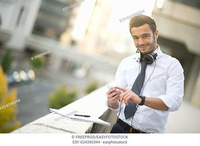 Businessman taking notes on a notebook in the city