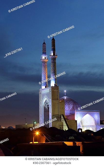 Jameh mosque at night with overview of Yazd, Iran, Asia