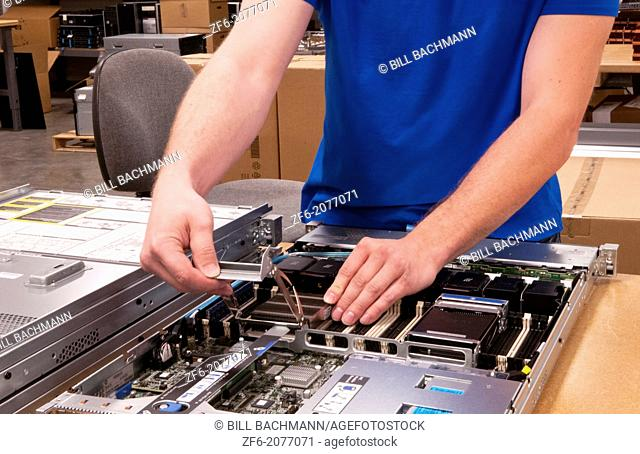 Close up of technician assembling server for computer IT company for shipment or repair