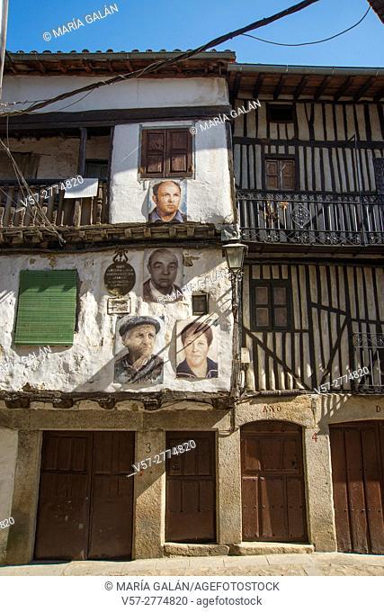Facades of traditional houses with portraits painted on them. Mogarraz, Sierra de Francia Nature Reserve, Salamanca province, Castilla Leon, Spain