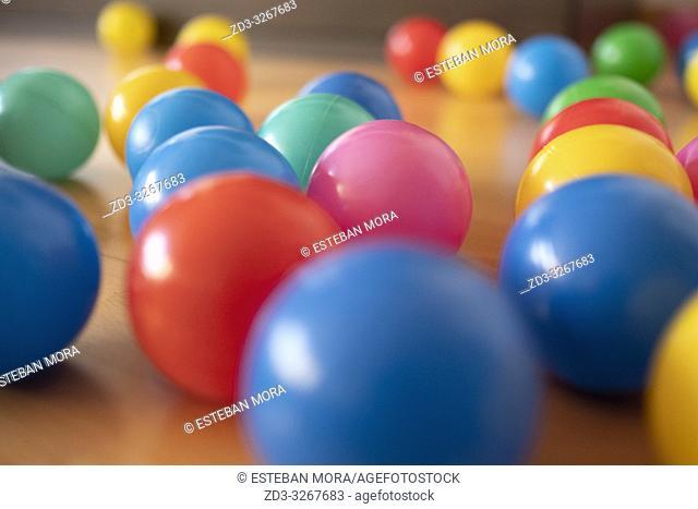 Colour balls on wood floor