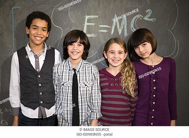 Children in front of blackboard
