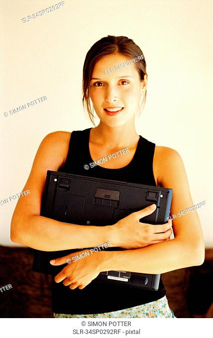 Woman holding laptop