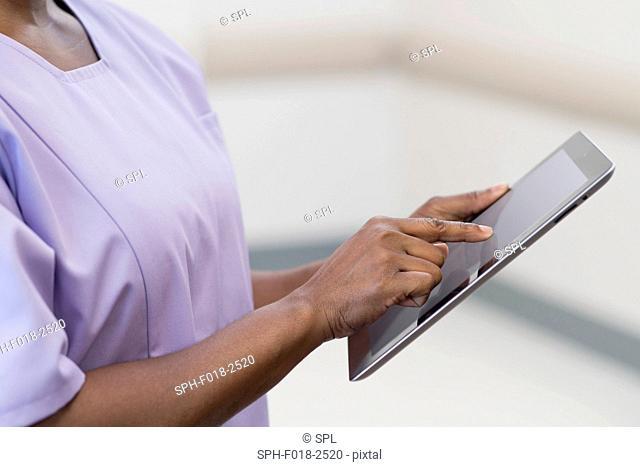 Female nurse using digital tablet