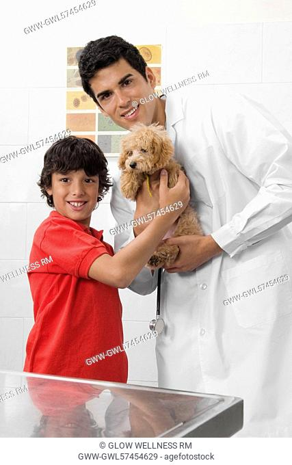 Vet and a boy carrying a dog