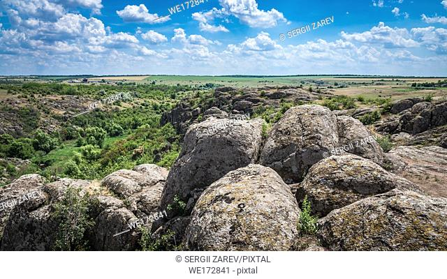 Panoramic view of deep granite Aktovo canyon with river and cloudy sky, One of the natural wonders of Ukraine