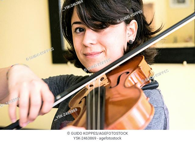 Tilburg, Netherlands. Young Italian violinist practising and rehearsing, in preparation of her conservatoire exam