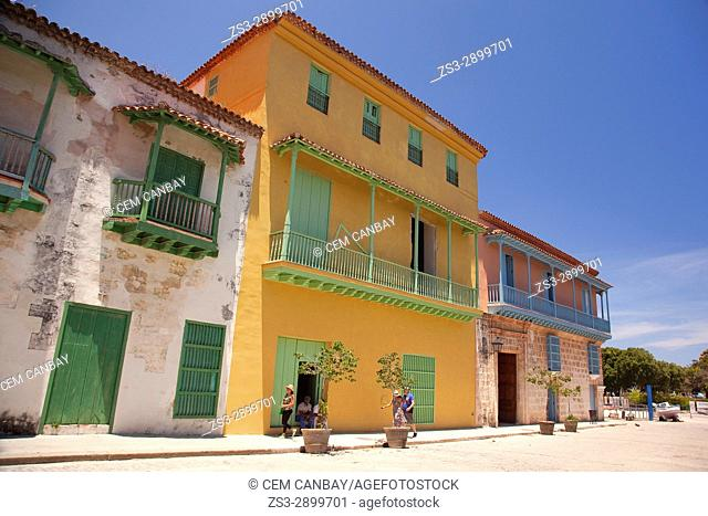 Tourists in front of the colonial buildings in Havana Vieja- Old Havana, La Habana, Cuba, West Indies, Central America