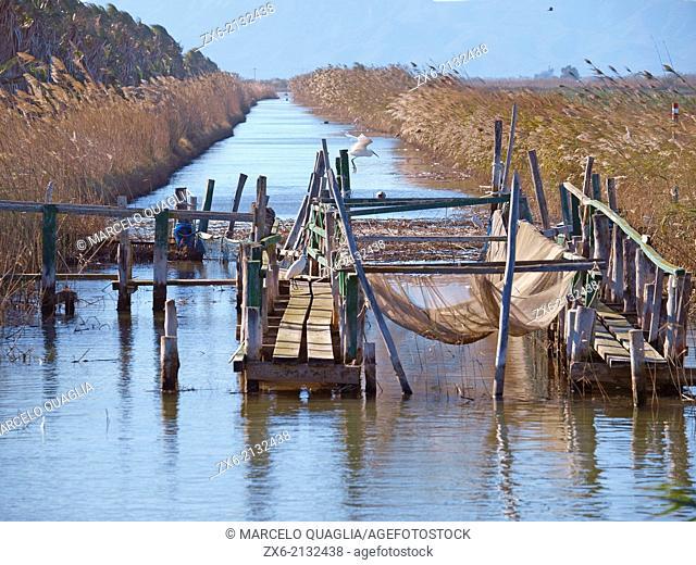 Funnel type fishing construction at irrigation ditch. La Marquesa Beach. Ebro River Delta Natural Park, Tarragona province, Catalonia, Spain
