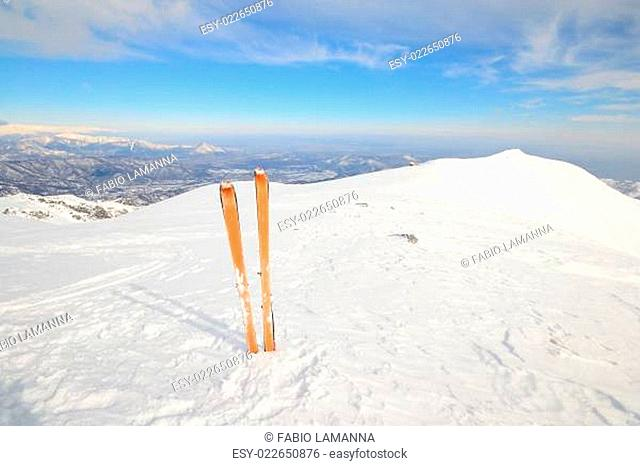On the mountain summit, tour ski and back country skiing equipment with avalanche safety tools