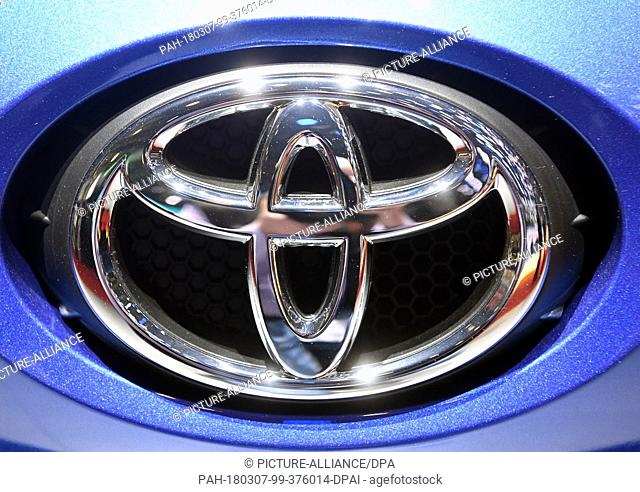 07 March 2018, Switzerland, Geneva: The logo of carmaker Toyota is displayed on the bonnet of an exhibited car during the 2nd Press Day at the 2018 Geneva Motor...