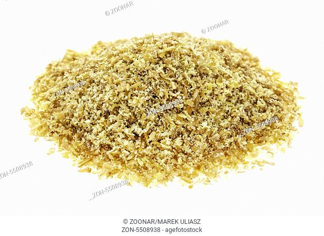 isolated small heap of golden flax seed meal