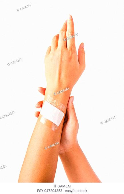 Adhesive bandage with transparent waterproof on hand wooman. Isolated on white background, Saved clipping path