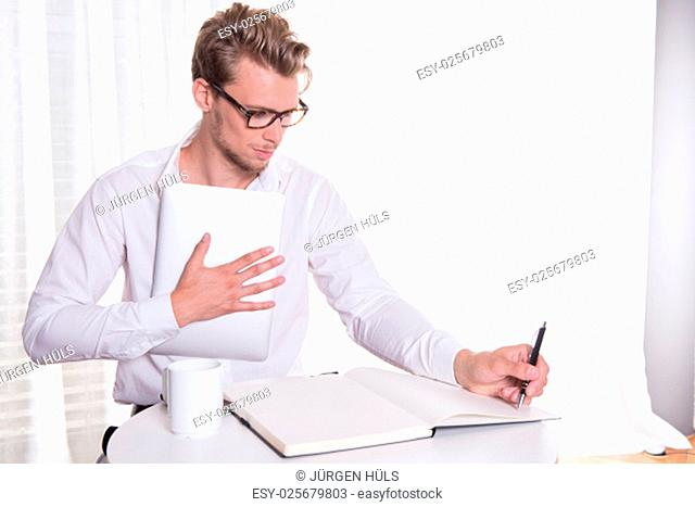 young business man taking notes